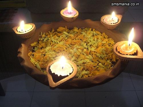 Group Of Diyas Lighting In WaterDiwali